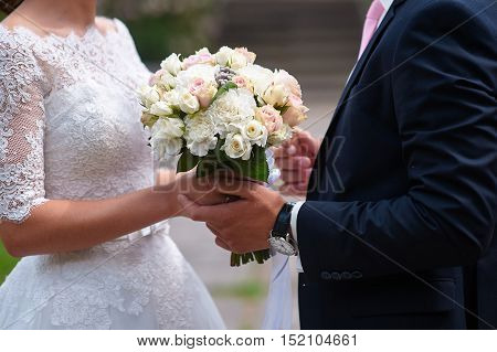 bride and groom holding hands in wedding day.