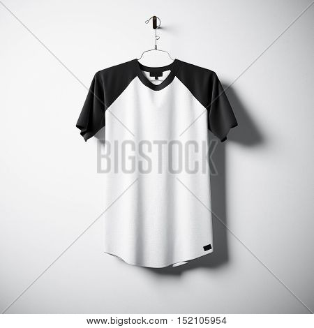 Blank black and white cotton tshirt hanging in center of empty concrete wall. Clear label mockup with highly detailed textured materials. Square. Front side view. 3D rendering