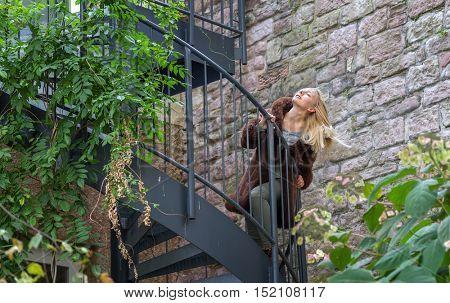 Young woman runs up at stairs