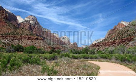 A pedestrian path inside of Zion National Park in southwestern Utah in the United States. Mountain View with colorful rocks and nature.