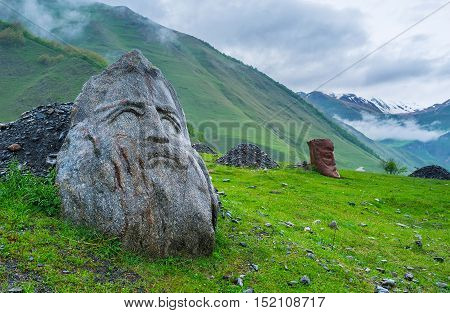 The small village of Sno is famous for its medieval and modern landmarks the large stone heads of famous Georgians (writers and poets) stand on the green meadow Georgia.