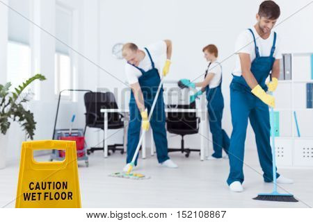 Cleaners Mopping Floor