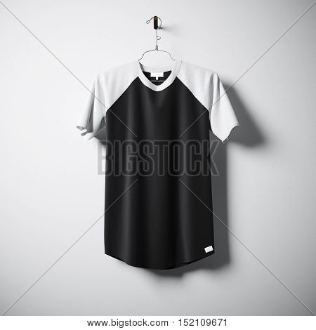 Blank cotton tshirt of white and black colors hanging in center of empty concrete wall. Clear label mockup with highly detailed textured materials. Square. Front side view. 3D rendering