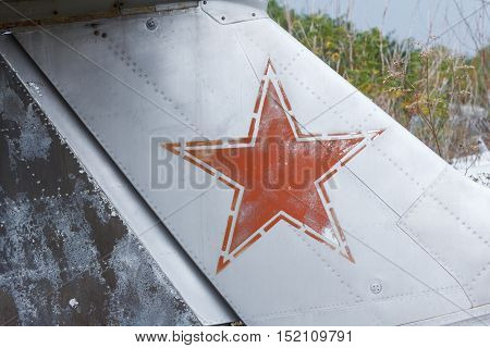 Old broken green russian airplane on the field. aircraft keel with star