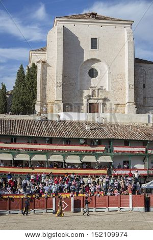 Chinchon Spain - October 15 2016: Traditional bullfighting stamp in the main square of chinchon during the festival charity Chinchon Madrid province Spain