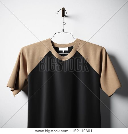 Closeup of blank tshirt brown and black colors hanging in center of empty concrete wall. Clear label mockup with highly detailed texture materials. Square. Front side view. 3D rendering