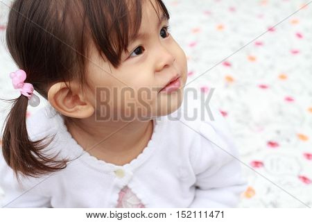 Smiling little Japanese girl (1 year old)