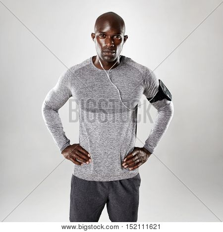 Handsome Young African Posing On Grey Background
