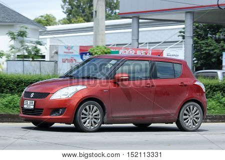 CHIANGMAI THAILAND - OCTOBER 6 2016: Private car Suzuki swift. Photo at road no 121 about 8 km from downtown Chiangmai thailand.