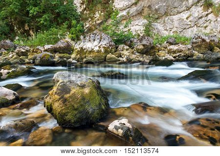 In the mountains of Abkhazia. The flow of water in a mountain river Yupshara.