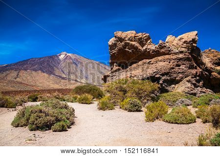 big volcanic cliff with the mount Teide on the background Tenerife Canary Islands Spain