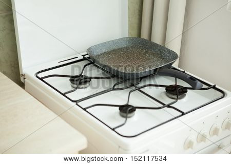A pan on a stove in a home kitchen