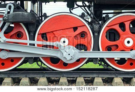 Locomotive side view. Close-up shoot of big loco wheels