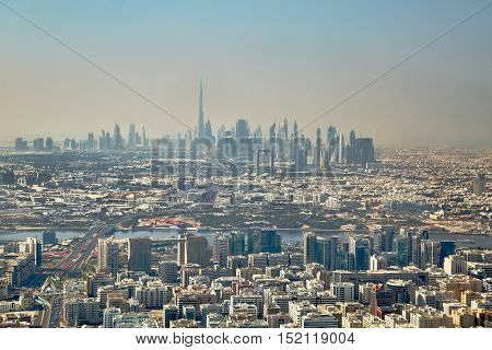 Dubai city view with skyscrapers in the distant haze