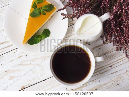 Cheesecake,  Coffee, Milk Jar And Heather Flowers