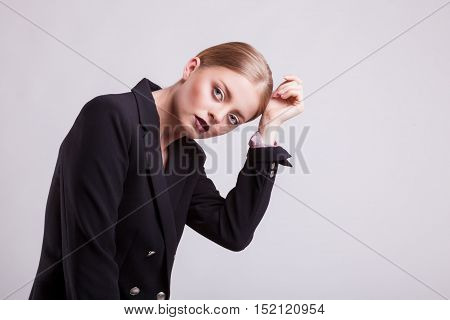 Model In Suit In Fashion Posing On Grey Background