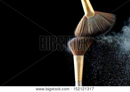 Professional brushes for powder and blush isolated on black background