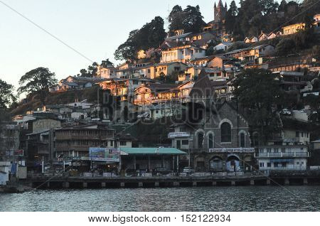 November 13, 2015: The beauty of Naini Lake and Bus stand area early in the morning at Nainital, Uttarakhand, India. Nainital is a popular hill station in Uttarakhand, named after the Goddess Naina Devi. It also known as the 'Gateway to Kumaon Himalayas'.