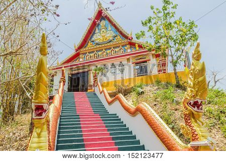 Phuket Thailand - April 25 2016 : The main stair leading to the replica of Phra That In-Kwaen (Hanging Golden Rock) at Sirey temple Phuket Thailand.