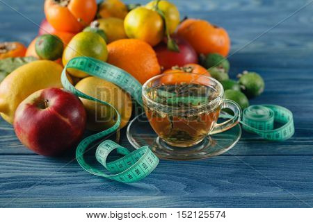 fruits diet meter with green tea and measure tape