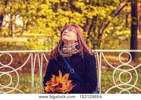 Beautiful Woman Sitting On A Bench.