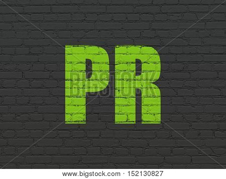 Marketing concept: Painted green text PR on Black Brick wall background