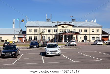Karlstad, Sweden - May 26 2016: Parking with parked cars in front of Karlstad airport terminal building.