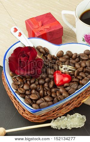 Romantic coffee. Marriage proposal. Coffee beans and a gold ring. Breakfast for lovers. Declaration of love on Valentine's Day.