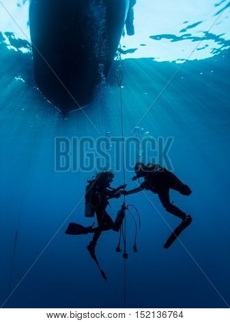 Scuba divers under the dive boat in Cyprus