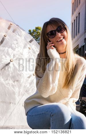 Pretty Blonde Girl Talking Telephone Cell Phone Mobile Daytime Sitting Blue Sky Warm