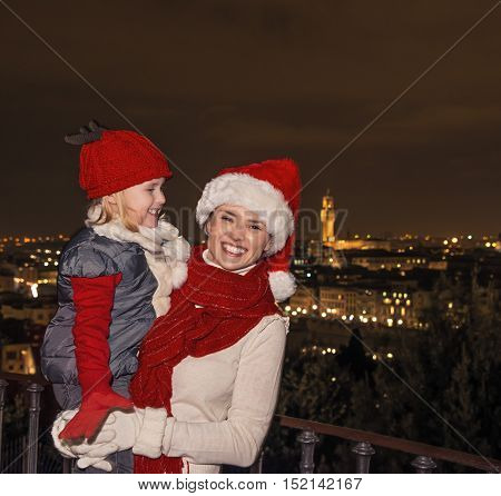 Happy Mother And Daughter Tourists In Christmas Hats In Florence