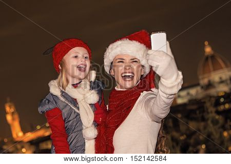 Mother And Child In Christmas Hats Taking Selfie In Florence