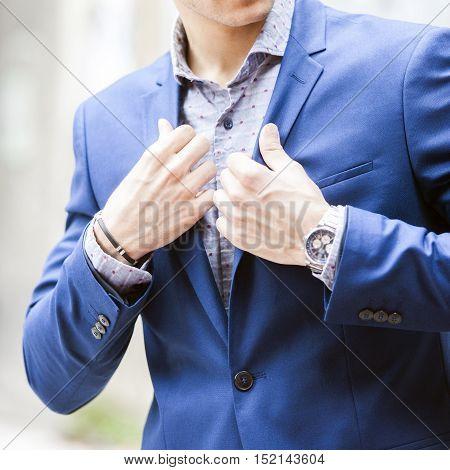 Man in fashion clothes shirt jacket, watch