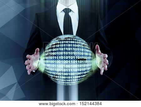 Businessman holding abstract binary code sphere on dark background