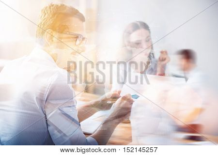 Worldwide business ideas. Bearded man sharing ideas to colleagues during meeting on background of worldwide connection with blurred double exposure.