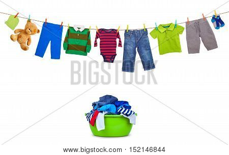 Laundry line with colorful clothes and plastic wash bowl with clothing isolated on white background