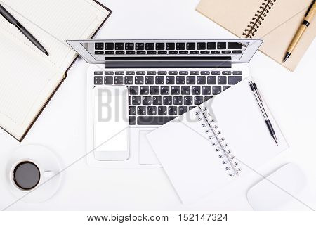 Office Desktop With Notepad And Technology