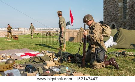 American And Russian Soldiers Relax In A Reconstituted Military Camp