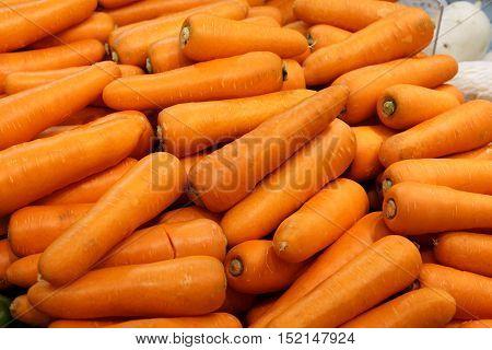 Orange raw carrot food background close up