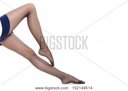 Beauty woman legs in black tights. Part body of slim attractive girl wearing dress skirt and pantyhose isolated on white.