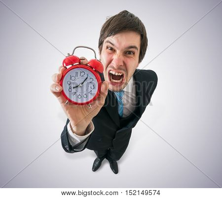 Deadline Concept. Young Crazy Boss Is Screaming And Holds Clock