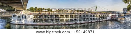 COLOGNE GERMANY - SEP 21 2016: skyline of Cologne with river Rhine in late afternoon and cruise ship