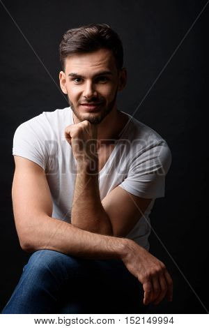 portrait of a modern happy male bachelor smiling in studio, isolated