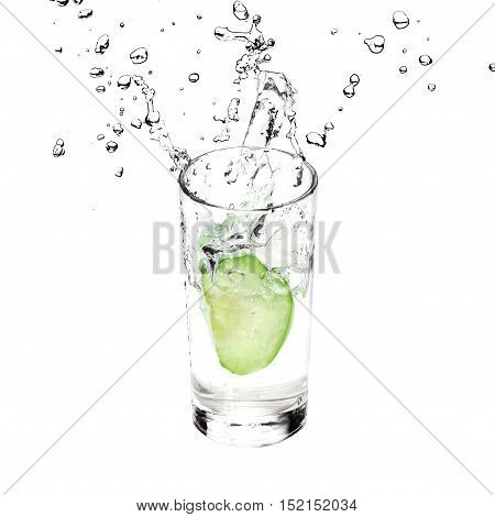 Green Apple is splashing in glass with pure water isolated on white background.