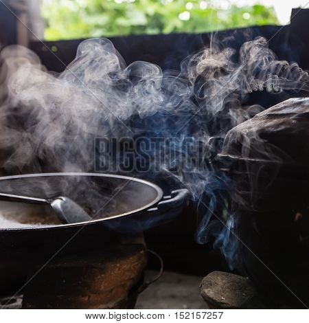Steam From The Rice Cooker By Using Firewood As Fuel