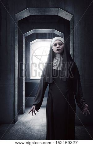 Asian Woman Dressed In Evil Nun Standing