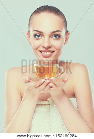 Beautiful girl holding a cup of tea on white background.