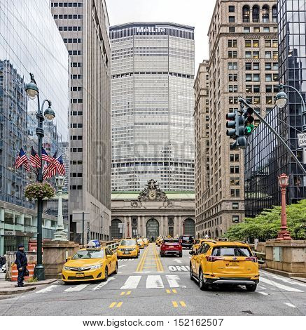 NEW YORK, NY, USA - OCT 13, 2016: Yellow cabs on Park Avenue in front of Grand Central Terminal and the Metlife building