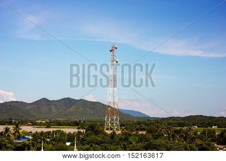 telecommunication tower middle of mountain background blue sky