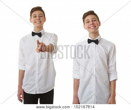 Set of cute teenager boy in white shirt and black bow tie pushing something in front himself over white isolated background, half body